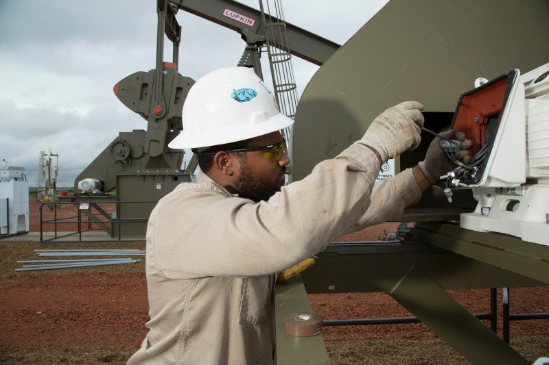 An employee working on equipment